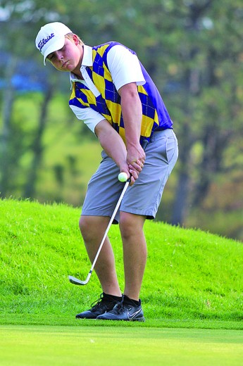 Ryder Bailey chips a ball onto the third green during the Custer Invitational last Thursday morning at Rocky Knolls Golf Course. Bailey finished with a team-best score of 85 at the meet.