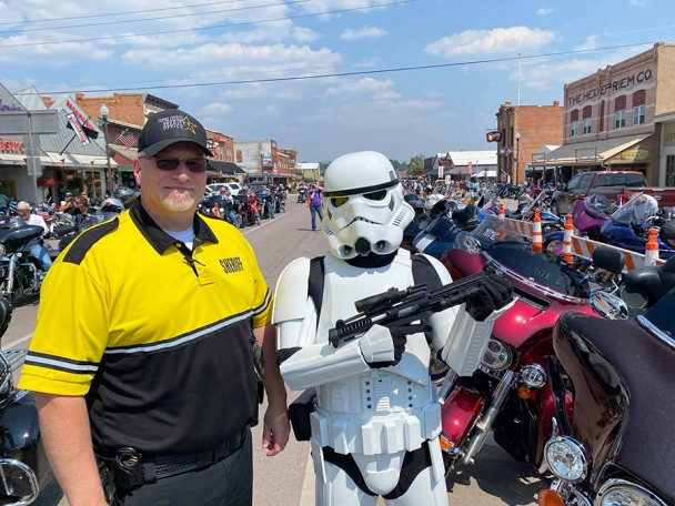 """Custer County Sheriff Marty Mechaley welcomes reinforcements that arrived Sunday from the Galactic Empire to help out with law enforcement during Custer Cruisin'. The picture was posted on social media with the caption: """"Our back-up stormtroopers have arrived. Y'all better behave now!"""" The imperial stormtrooper came to Custer via Hot Springs and was reportedly riding a plain old two-wheeled motorcycle instead of a flying speeder bike."""