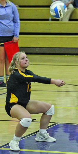 Junior defensive specialist Bailey Baker digs the volleyball up in Thursday's home game against Belle Fourche.
